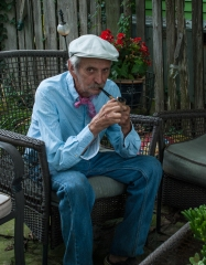 Lowell Davis enjoys his pipe while we eat popsicles he provided.